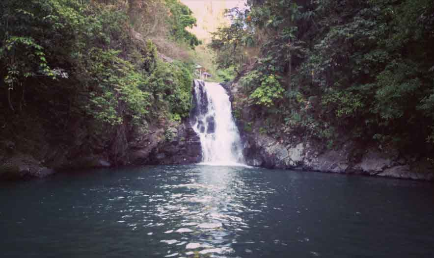 Jumping Off Waterfall Cliff in Bali
