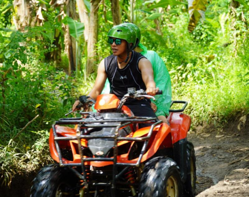 ATV Riding Adventure in Green Forest