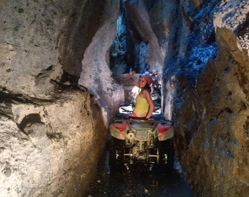 Riding ATV at Bali Cave