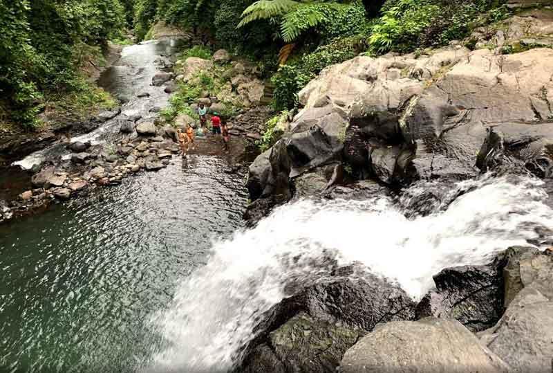 Jumping Off Kembar Waterfall