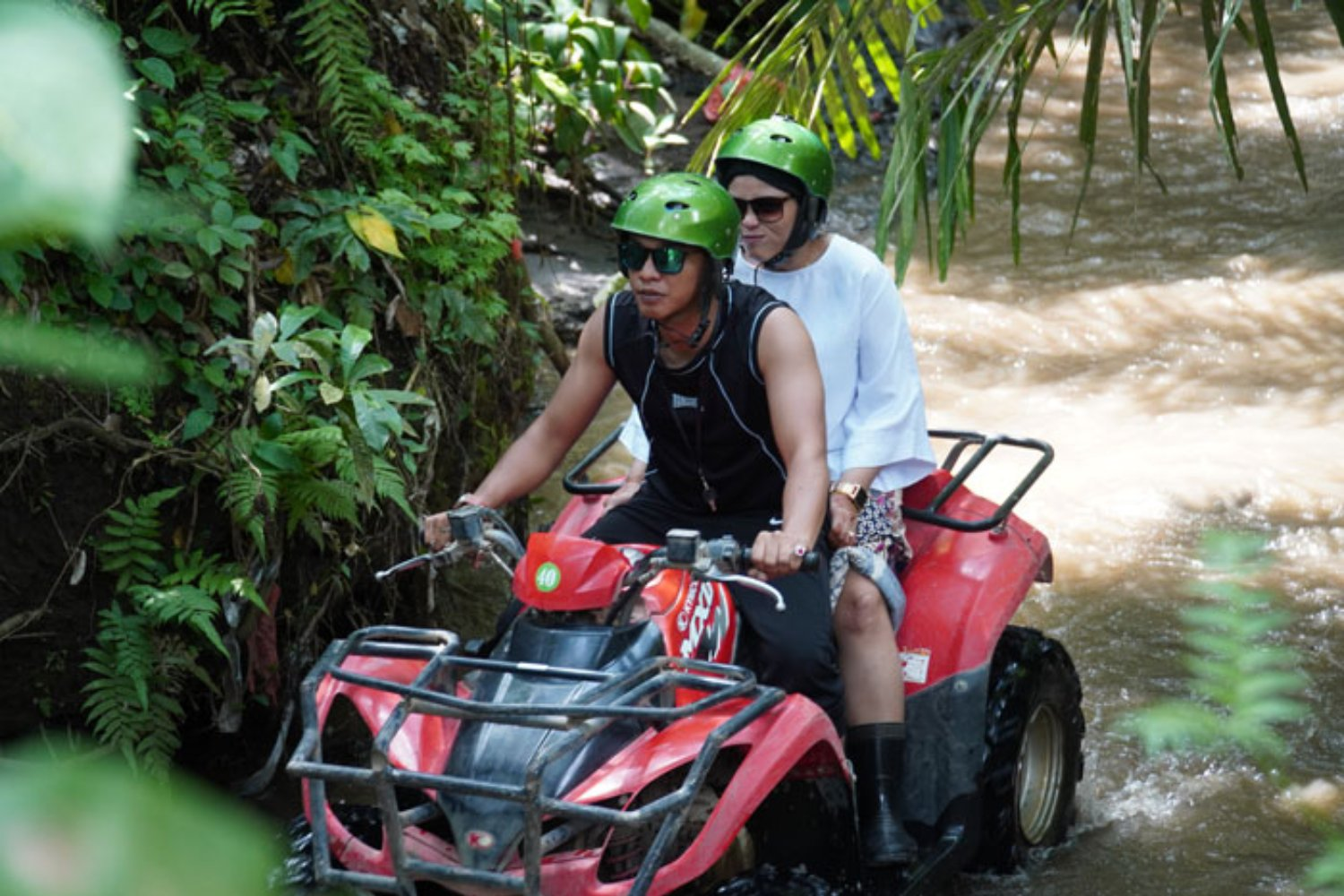 Riding ATV on River Track